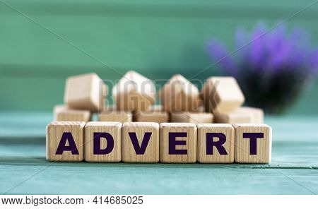 Advert - Word On Wooden Cubes On A Green Background With Lavender. Business Concept
