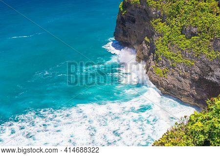 Large Waves Crash On A Rocky Coast, Bali, Indonesia.