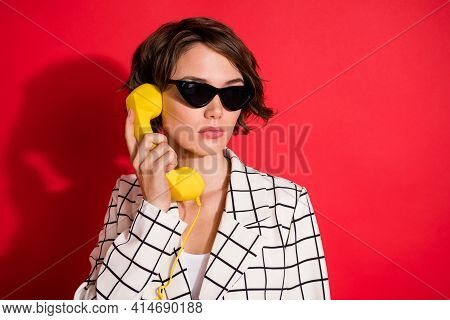 Photo Of Young Attractive Girl Serious Answer Cable Phone Landline Conversation Isolated Over Red Co