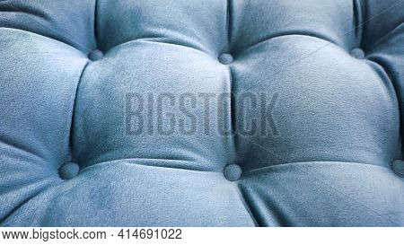 Detail Of Upholstery Of Modern Sofa, Chair, Armchair, Pouf Or Pillow. Carriage Coupler. Gray Color.