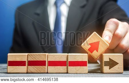 Businessman Makes Changes To The Business Process On An Alternative Path. Defining A New Action Plan