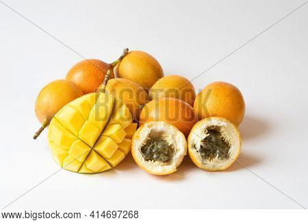 Tropical Fruit Salad With Mango, Kiwi, Passion Fruit, Granadilla, On White Background, Copy Space. D