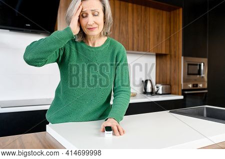 Middle-aged Grey-haired Woman Feels Unwell, Measuring Blood Pressure And Pulse Pulse Rate, Holding H