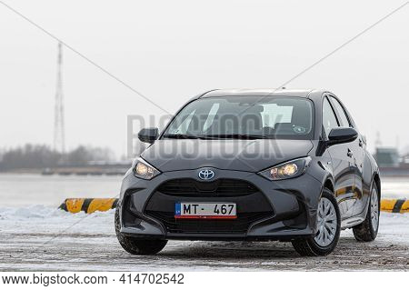 Riga, Latvia - February 9, 2021: Metallic Graytoyota Yaris Hybrid Y20 Edition Hatchback Car Parked O