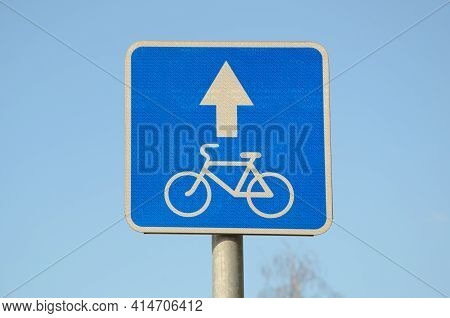 Blue Square Metal Traffic Sign Bicycle Traffic With Reflective Surface Against Blue Sky. Regulation