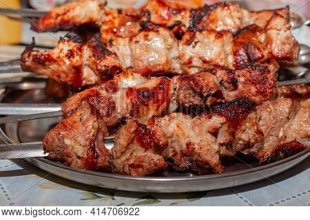 Delicate Juicy Tasty Pork Meat Baked On The Grill On Skewers Lies On A Metal Tray. Gastronomic Orgas