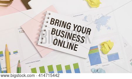 Bring Your Business Online. Text On White Paper On Wood Background Near Calculator, Paper Clips.