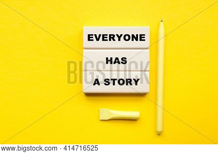 Words Everyone Has A Story Written On Cubes . You Can Use In Business, Marketing And Other Concepts.