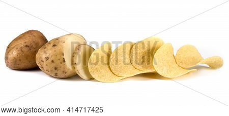 Potato Chips And Raw Potatoes On A White Background. A Portion Of Potato Chips And Raw Potatoes On A