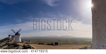 Panorama Of Traditional Whitewashed Spanish Windmills In La Mancha On A Hilltop Above Consuegra With