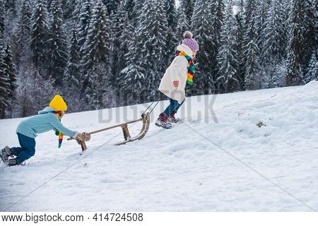 Kids Riding Sledding Slide. Children On Snow Landscape, Winter Snowy Fun Activities. Sled Speed Ridi
