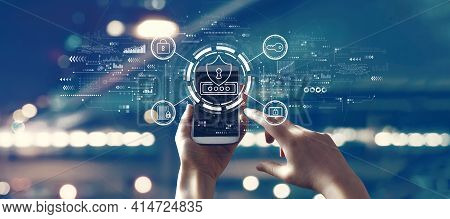 Cyber Security Theme With Person Using A Smartphone