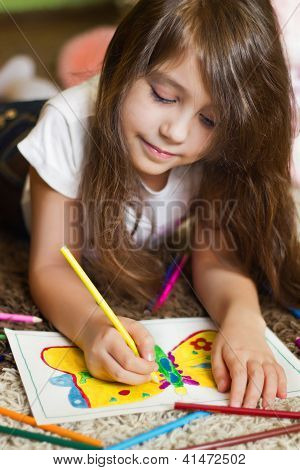Lovely girl drawing a picture