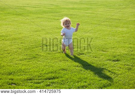 Cute Funny Laughing Baby Learning To Crawl, Having Fun Playing On The Lawn Watching Summer In The Ga