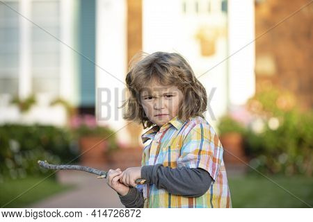 Kids Conflict. Child Aggression. Negative Emotion Concept. Angry Bully Boy With Danger Stick. Kid Ad