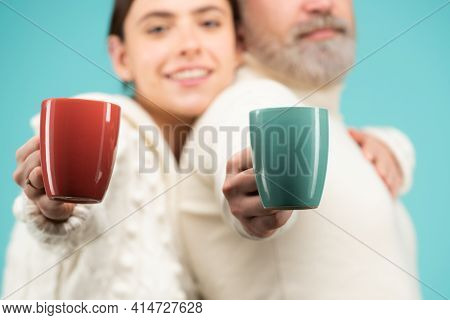 Family Coziness Concept. Happy Couple At Routine Morning With Cup Of Coffee Or Tea. Enjoying Nice Fa