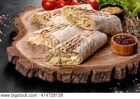 Delicious Fresh Shawarma With Meat And Vegetables On A Dark Concrete Table