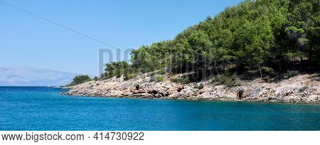 Wild Pine Forest Along Hvar Island, Coastline Of Adriatic Sea. Maslinica Beach, Public Bathing Place