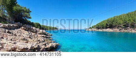 Wild Pine Forest Along Hvar Island, Coastline Of Adriatic Sea. Maslinica Beach, Public Bathing Place
