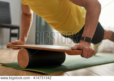 Selective Focus On Balance Board Used By Strong Middle Aged Caucasian Athlete Doing Push Ups Exercis