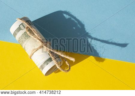 Twisted Bundle 100 Dollar Bills On A Yellow Background. Business Concept