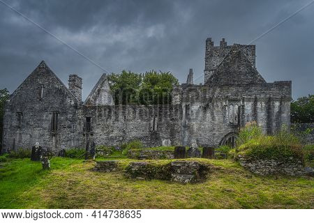 Ancient Graveyard In Front Of Ruins Of 15th Century Muckross Abbey With Dramatic Storm Sky, Killarne