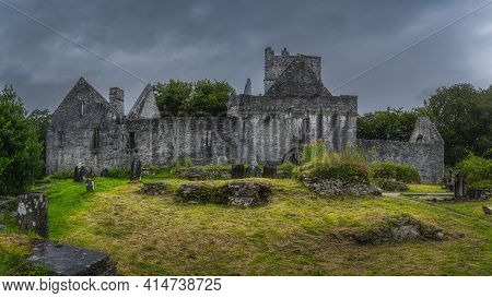 Ancient Graveyard And Tombs In Front Of Ruins Of 15th Century Muckross Abbey With Dramatic Storm Sky