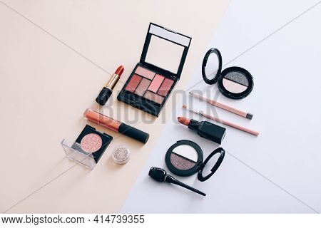 Makeup Palettes With Shadows And Concealers. Make Up Products On Light Background, Top View