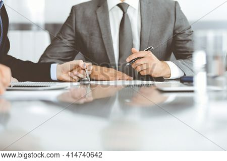 Unknown Business People Working Together At Meeting In Modern Office, Close-up. Businessman And Woma