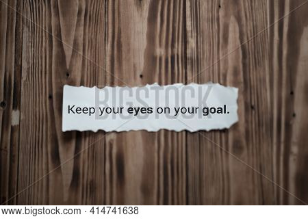 Inspirational Quote - Keep Your Eyes On Your Goal. Notes Message On White Torn Paper Note On Brown W