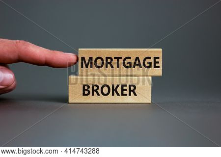 Mortgage Broker Symbol. Concept Words 'mortgage Broker' On Wooden Blocks On A Beautiful Grey Backgro