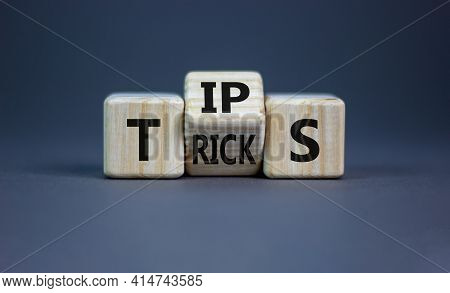 Tips And Tricks Symbol. Turned The Wooden Cube And Changed The Word 'tips' On 'tricks'. Beautiful Gr