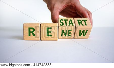 Renew And Restart Symbol. Businessman Hand Turns Cubes And Changes The Word 'renew' To 'restart'. Be
