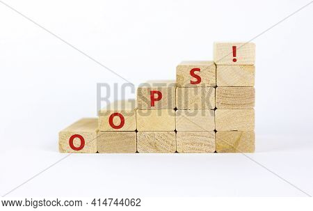 Oops Symbol. Oops Sign On Wooden Cubes. Beautiful White Background, Copy Space. Business And Oops Co