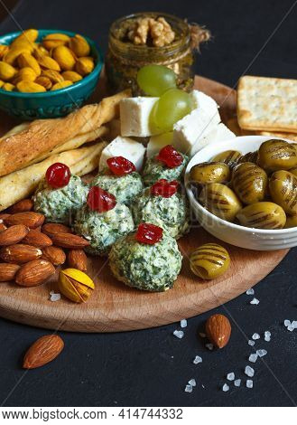 Assorted Snacks For The Party Close Up. Balls Of Cream Cheese With Spinach, Dried Olives, Homemade P