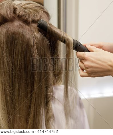 Invisible Hairdressers Hands Make A Customer Hair Perm