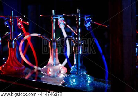 Multicolored Hookah In The Restaurant. Hookah Elements On The Background Of The Restaurant.