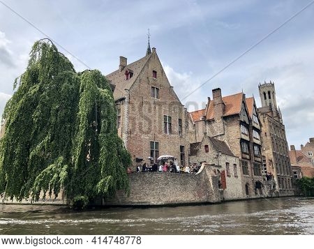 Brugges, Belgium - May 27, 2019 - Tour In Brugges Canals With Lovely Scenary And Classic Architectur