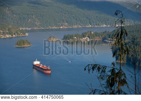 Oil Tanker at Anchor. An oil tanker anchored in Burrard Inlet. Vancouver, British Columbia, Canada.