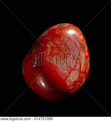 Polished Red Jasper Mineral Stone From Brazil Isolated On Black Background. For Geology Or Mineralog