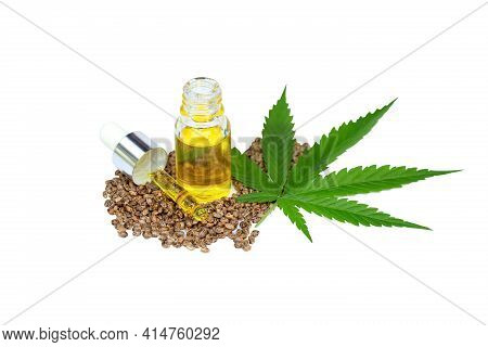Cbd Cannabis Oil. Hemp Oil Capsules And  Hemp Seed Isolated On White Background. Medical Marijuana C