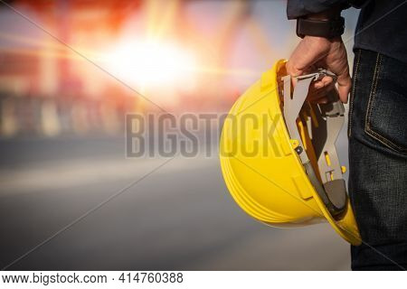 Engineer Holding Helmet On Site Road Construction For The Development Of Modern Transportation Syste