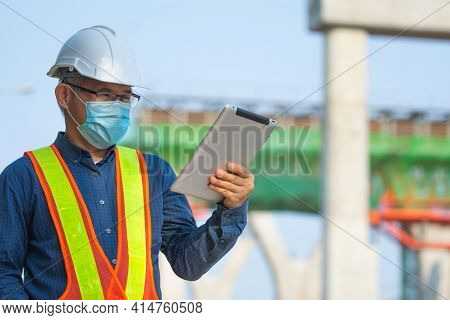 Asian Man Senior Engineer Expert Professional Use Tablet Work On Site Construction, Then Man Wera Fa