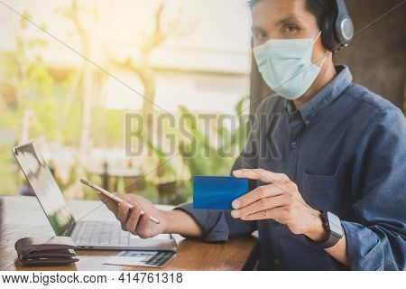 Close Up Hand Holding Mobile Phone Shopping Online With Credit, Man Stay At Home Protect Coronavirus