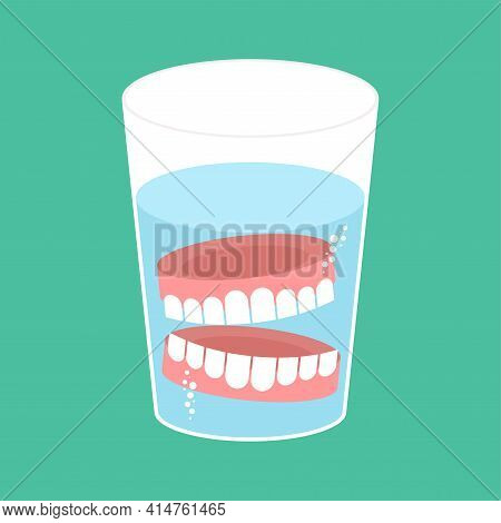 False Teeth In Glass. False Jaw In Glass Beaker
