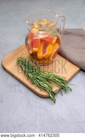 Detox Citrus Infused Flavored Water. Iced Drinks With Fresh Fruits. Jar Of Traditional Red Spanish S