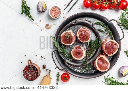 Raw Fresh Marbled Meat Steak Filet Mignon. Beef Tenderloin Steaks Wrapped In Bacon Served On Old Mea