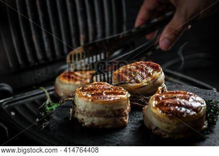 Grilled Fillet Mignon Tenderloin Meat Beef Steaks Fillet Wrapped In Bacon. Cooking Beef Steak On Gri