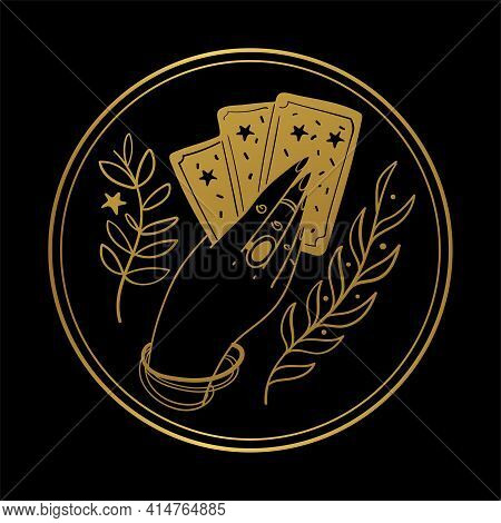 Graceful Female Hand Of A Gypsy Woman Holds Tarot Cards. Round Gold Icon On A Black Background. The