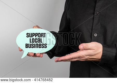 Support Local Business. Business Man With Speech Bubble In Hand